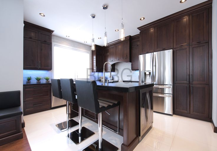 Transitional kitchen style with oak cabinet.