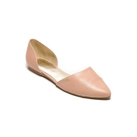 """Tommy Hilfiger women's shoe. Flat out fabulous. Our chic, pointy-toe flat is dressed in pinstripes for that oh-so-summery feel. With an extra cushiony insole so they feel as good as they look. • Flat silhouette with synthetic upper.• Textured rubber outsole.• .4"""" heel.• Imported"""