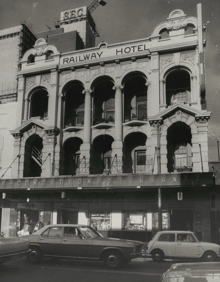 Western Australia: Railway Hotel, Barrack Street, 1972.  All that remains of this building is the facade, which has been integrated into the Medina Executive Barrack Plaza Hotel. This is a perfect example of Perth's attitude towards heritage preservation.In 1992Joe Scaffidi, Lord Mayor Lisa Scaffidi's husband,demolished part of the hotel facade and became the first person to be prosecuted under the Heritage Act. He was ordered to rebuild the facade