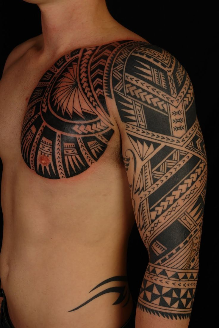Polynesian chest plate arm sleeve tattoo by shane gallagher