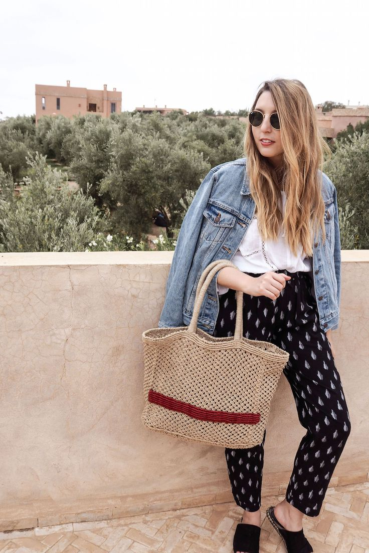 Summer Travel Outfit Of Kirei Ikat Trousers, Urban Outfitters White Blouse, Levis Denim Jacket, Mango Jute Tote Bag, Ray Ban Sunglasses | Wolf & Stag