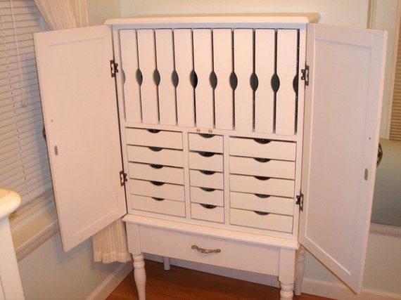 Custom Jewelry Armoire Storage: 1 large bottom drawer 5 small drawers 9 vertical drawers for necklaces 10 large drawers Measurements: 49in tall x 28.5in wide x 13in deep SAGilson – Etsy