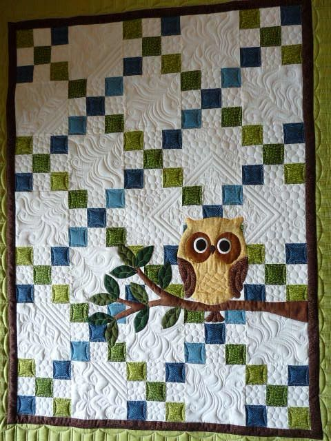 Love the owl appliqué over the Irish chain quilt, and the finish quilting is as great as the piecing and appliqué.