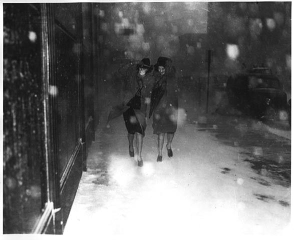 "stuffaboutminneapolis:  ""Women walking on Minneapolis sidewalk during Armistice Day blizzard. (11-11-1940) via Minnesota Historical Society  The Armistice Day Blizzard Ranks #2 on the Minnesota State Climatology Office Top five weather events of the..."