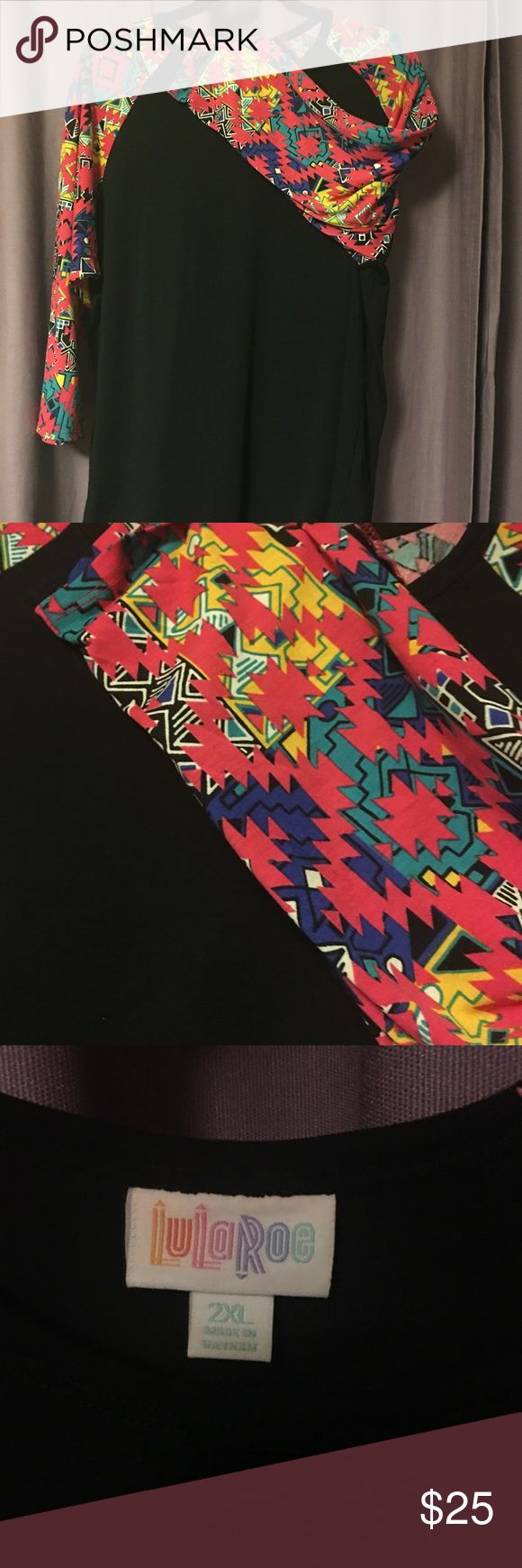Lularoe Randy - BNWOT Rare black body with pink, teal, yellow, blue and white Aztec design. BNWOT. Never worn. Never washed. Jumped the gun and took tags off before I tried it on. Perfect condition, just not my style. LuLaRoe Tops Tees - Long Sleeve