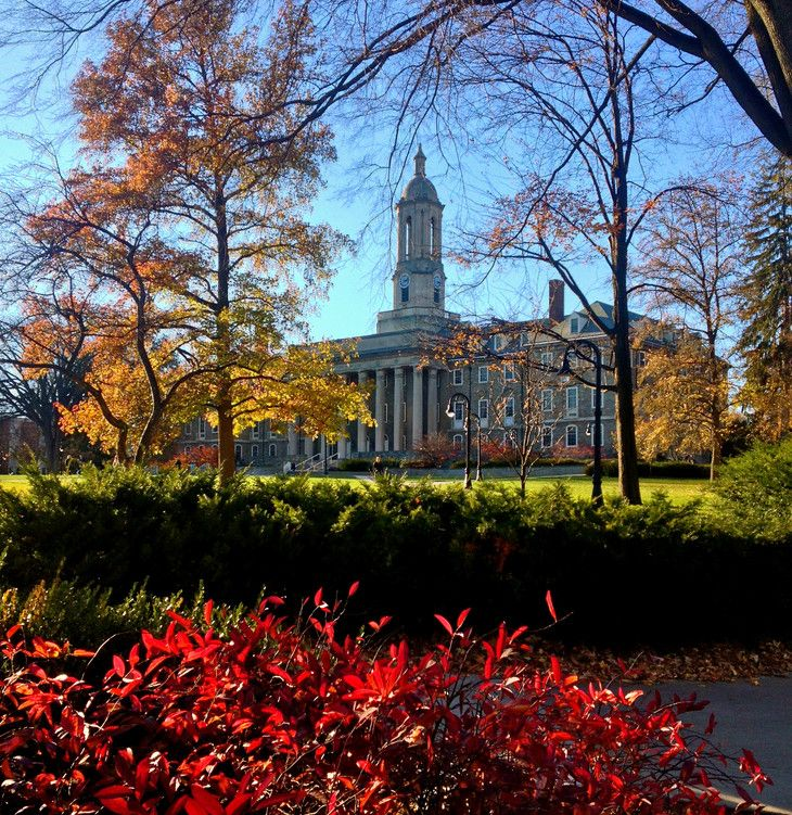 Old Main with bright red foliage in the foreground