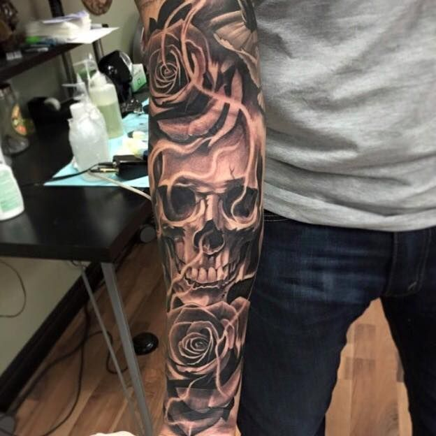 Full sleeve skull Tattoo by Ricardo Avila