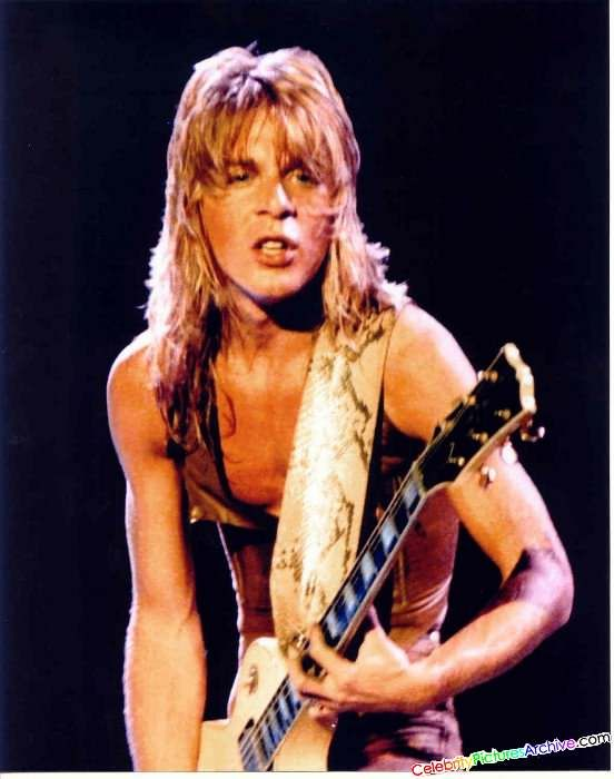 A magician on the fretboard who went off the rails entirely to young......Randy Rhodes.....