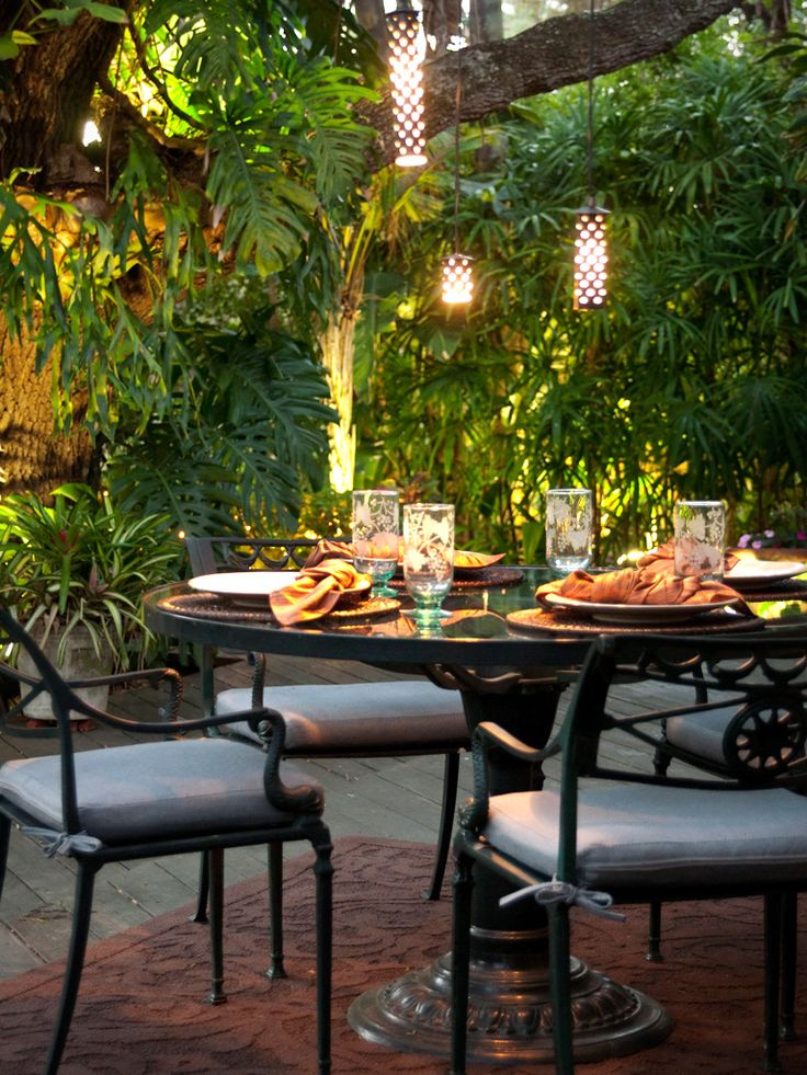 Outdoor Dining And Cylindrical Lighting Adds A Cozy Atmosphere To This Deck