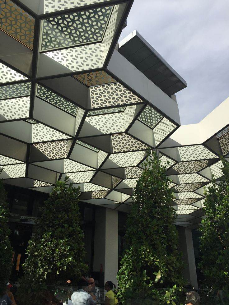 The external honeycomb shaped canopy matches the internal aluminium light fitting which creates a sense of continuity between inside and outside.
