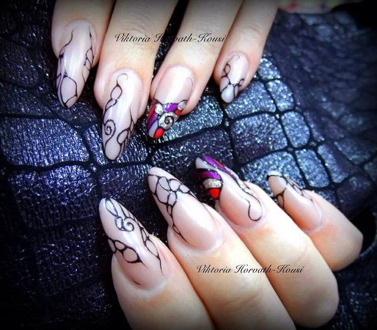 Almond shaped acrylic nails with gel design