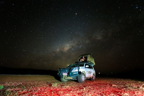 Stargaaaazing from the Car by eetschman  red travel car stars sand australia wheels gras lightpainting milky way adventure tent off road nigh