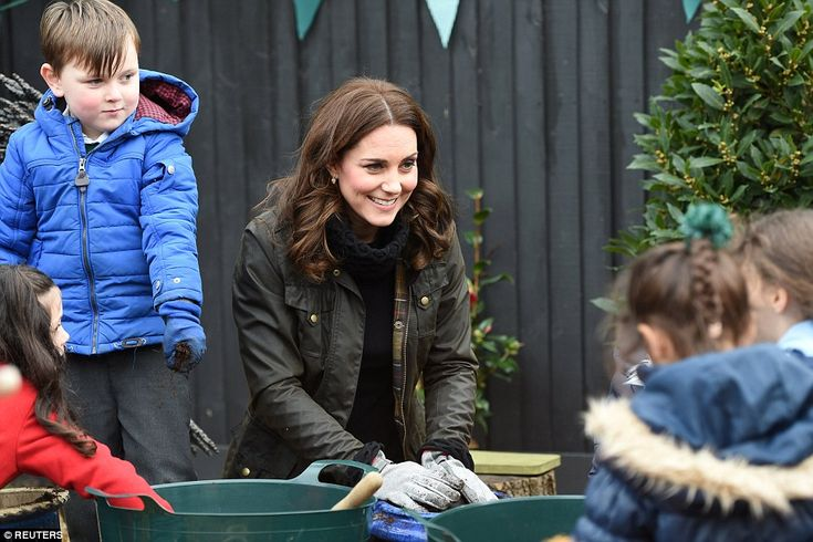 Kate proved to be a good sport as she got stuck into a spot of gardening with the local sc...