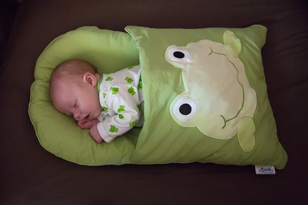 This is a great idea! A pillow case remade...perfect for traveling and naps...  baby sleeping bag!