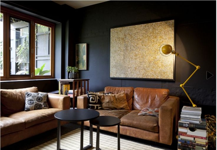 Melbourne living room with great contrast of dark walls and tan leather sofas  Black ...