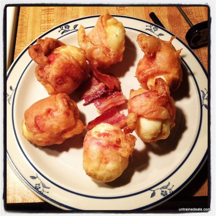 Deep Fried Bacon Wrapped Deviled Egg    The perfect breakfast in a bite. Recipe at http://untrainedeats.com/2012/07/02/deep-fried-bacon-wrapped-deviled-eggs/