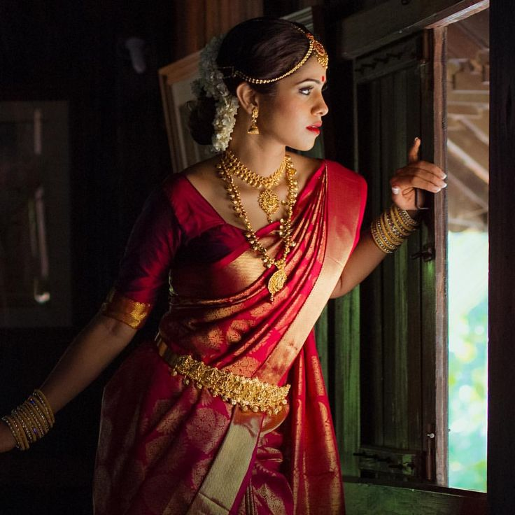 South Indian bride. Gold Indian bridal jewelry.Temple jewelry. Jhumkis. Red silk kanchipuram sari.Braid with fresh flowers. Tamil bride. Telugu bride. Kannada bride. Hindu bride. Malayalee bride.Kerala bride.South Indian wedding.