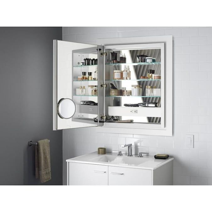Kohler Verdera 24 In X 30 In Lighted Led Surface Recessed Mirrored Rectangle Medicine Cabinet With Outlet Lowes Com In 2021 Lighted Medicine Cabinet Bathroom Medicine Cabinet Mirror Medicine Cabinet Mirror
