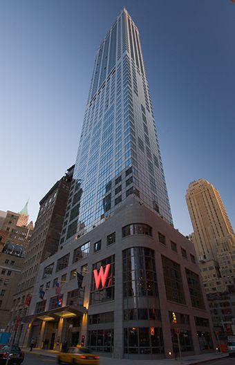 Exterior Signage. Poulin + Morris - W New York Downtown Hotel & Residences. A strong example of large, opaque, lit sign standing out against a busy facade.