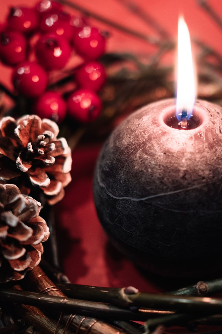 Christmas wreath and a round candle closeup