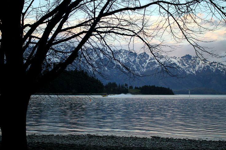 Queenstown Lake #lake #water #beautiful #mountains #snow #tree #silhouette #queenstown #newzealand #nz