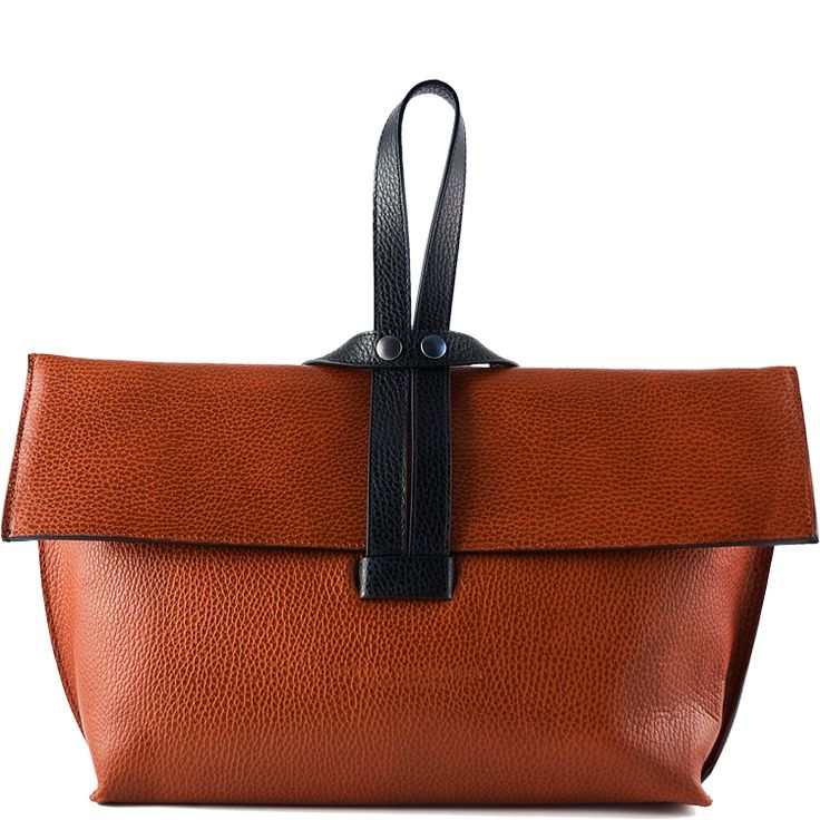 Description    Details    Story  Touch & Feel     Inspired by boats that sail the Nile, this distinctive bag can adorn your hand or be worn on your shoulder. The wrist strap echoes a mast and is the visual and functional focal point in the design and closure. This limited signature edition bag is numbered and personally signed by Hester van Eeghen. Handcrafted in Italy.  Cognac, Black       Textured Italian calfskin   Hester van Eeghen embossment   Folding front flap with snap closure…