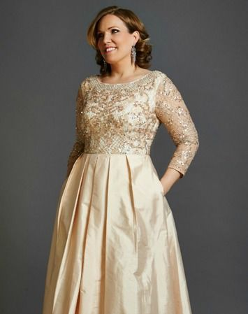 What to wear: Mother of the Bride - Delicate and understated, this blush gown is the epitome of elegance. Sequins and beads shimmer on the soft peach lace bodice, making it perfect for a black-tie occasion, while the crinkle taffeta gown with pockets creates a relaxed balance, making this ballgown seem effortless. Perfect for weddings (think Mother of the Bride or Groom or even a non-traditional bride). Shop this look here…