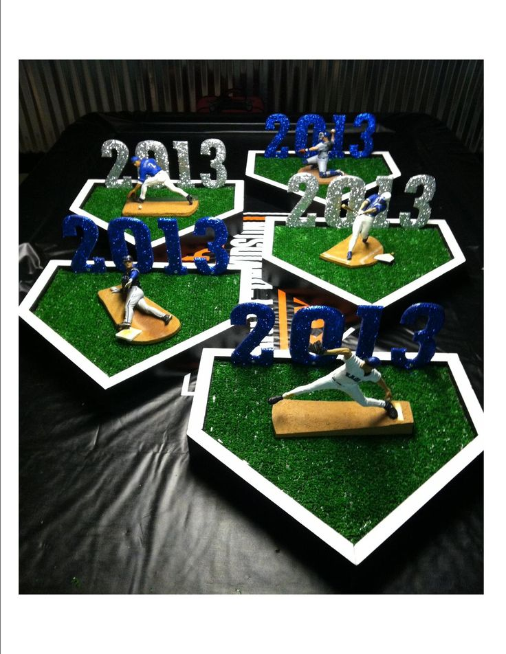 baseball table centerpieces i made for graduation party (each figure was personalized with his high school name,colors and his jersey# and name on back).