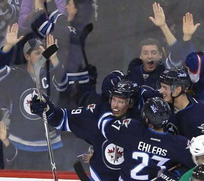 Fans react as Winnipeg Jets right winger Patrik Laine (c) celebrates his third goal of the game against the Dallas Stars with winger Nikolaj Ehlers (l) and defenceman Tyler Myers during NHL hockey in Winnipeg, Man. Tuesday November 08, 2016. Brian Donogh/Winnipeg Sun/Postmedia Network - Patrik Laine