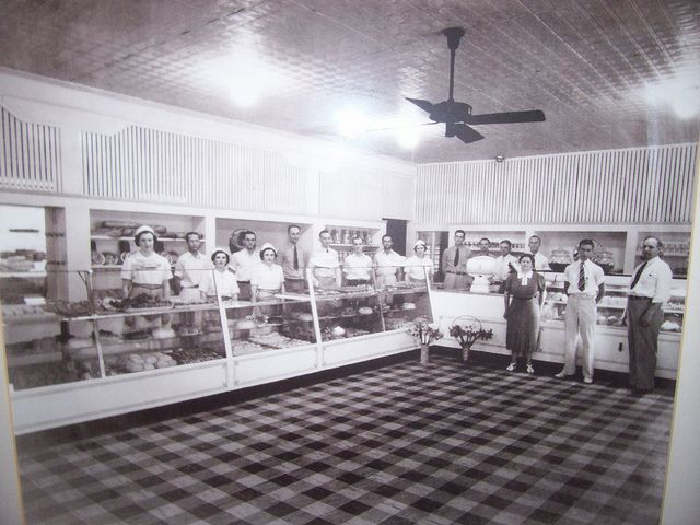 nterior of Carl's Bakery, 710 E. Gadsden St.    Popular bakery in Old East Hill, located at the corner of Gadsden and 8th Avenue. Closed late 1960s or early 1970s. This photo looks like 1930s or 1940s. Now renovated, Strobel  Hunter Architects' office.
