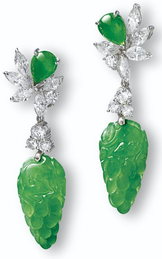 Jadeite and diamond earrings. Each suspending on a translucent jadeite of intense apple green colour carved to the front and back with grapes and bat motifs, surmounted by a pear-shaped jadeite cabochon of matching colour and translucency,decorated with marquise-, pear-shaped and brilliant-cut diamonds, the diamonds altogether weighing approximately 1.80 carats, mounted in 18 karat white gold, pendants detachable.