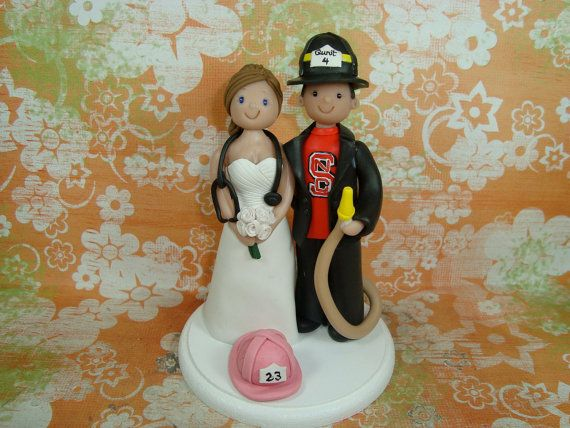 Nurse and Firefighter cake topper :) ! OMG YES! FIREFIGHTE AND NURSE AND BOTH BLACK AND PINK FIRE HELMET! <3 <3 <3