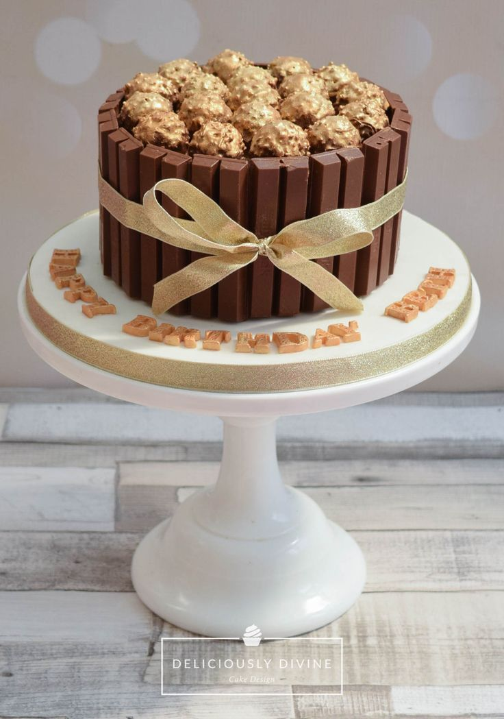 Ferrero rocher and kitkat cake.  Vanilla sponge layered with nutella buttercream and gold painted fererro rochers for decoration.  Adorned with a gold ribbon and placed on an iced board with gold lettering.   An ideal cake for any girls,  birthday, be it mum, grandma, auntie, sister or daughter, young or old and would make a fabulous wedding cake, particularly if additional tiers were added. Message me to order or make an enquiry lee-anne@deliciouslydivine.co.uk