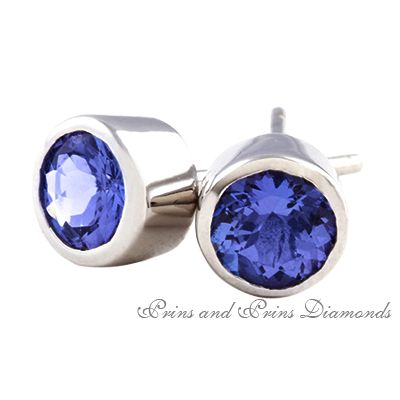 18ct white gold tanzanite tube set stud earrings, with 2x 1.00ct round brilliant cut tanzanites.  We have a wide selection in our showroom. Contact us to ask for quotes on various sizes.