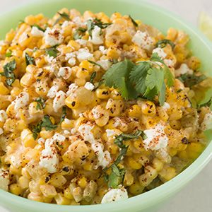 Deconstructed Mexican Street Corn 1 14.5-ounce can diced green chilies, drained ¼ cup sour cream ¼ cup mayonnaise 1 tablespoon fresh-squeezed lime juice ½ teaspoon chili powder 1 small garlic clove, minced 2 15-ounce cans whole kernel corn, well drained ½ cup finely crumbled cotija cheese or feta cheese 2 tablespoons chopped fresh cilantro
