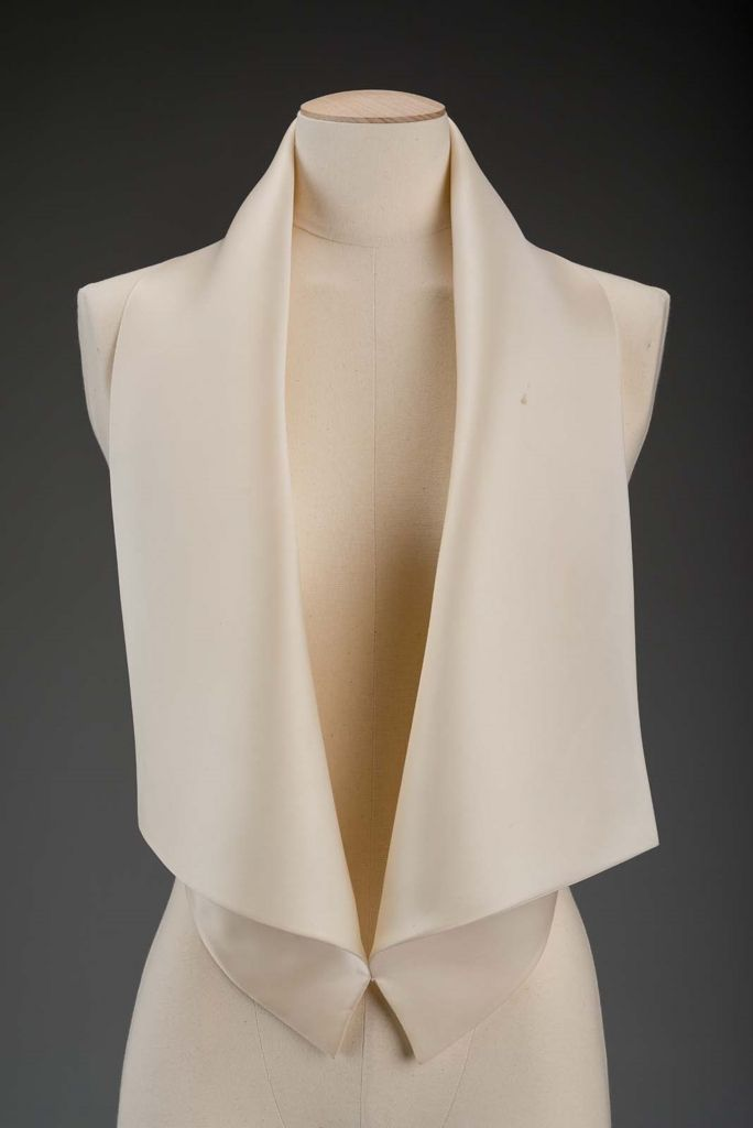 Woman's top | Designed by Gnyuki Torimaru, Japanese, worked in England, born in 1937 | England, 1987 | White silk satin halter top with wide lapels, resembles man's waistcoat. Four buttons close the lower center back | Museum of Fine Arts, Boston