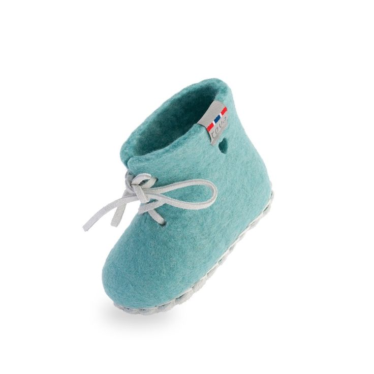 TOVA WOOL SLIPPER - MY FIRST SLIPPER - mint. The Perfect Gift for Babies! 100% Merino wool with a genuine suede sole and white leather laces. This soft and comfortable style allows your baby's feet to move freely.  Wool's naturally insulating and breathable properties keep your baby's feet dry and warm.  Suede soles provide a natural anti-slip surface. Shoe box comes wrapped in a cotton bag.