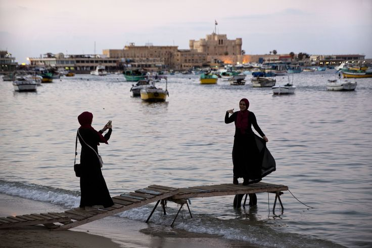 Alexandria, Egypt  Tourists pose for a picture by the Mediterranean Photograph: Amr Nabil/AP