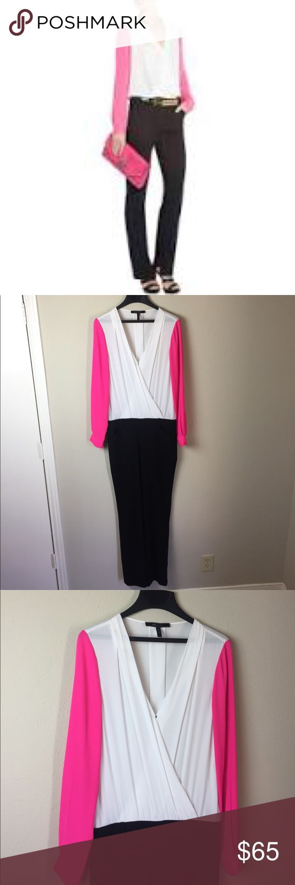 """BCBGMaxAzria Remington Color Block Jumpsuit Color block jumpsuit with white on top, black pants, and pink sleeves. It has belt loops, slits at the bottom of the pants, and button close cuffs. Wrap style front with a snap close to keep everything tucked away. 😄 There is one tiny spot on the top left of the white area (please see pic #7). 23"""" armpit to armpit. Waist of pants is 16"""" across. 64"""" in length. BCBGMaxAzria Pants Jumpsuits & Rompers"""