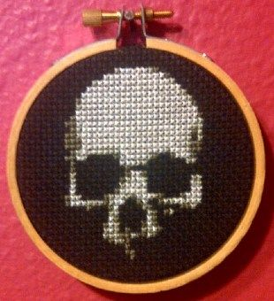 """""""Skull On Black"""" - From CrassCross. The cross stitch pattern to make this piece is available for just $3.  Now available at my NEW STORE, CrassCross.com! Click the pic to check it out!"""