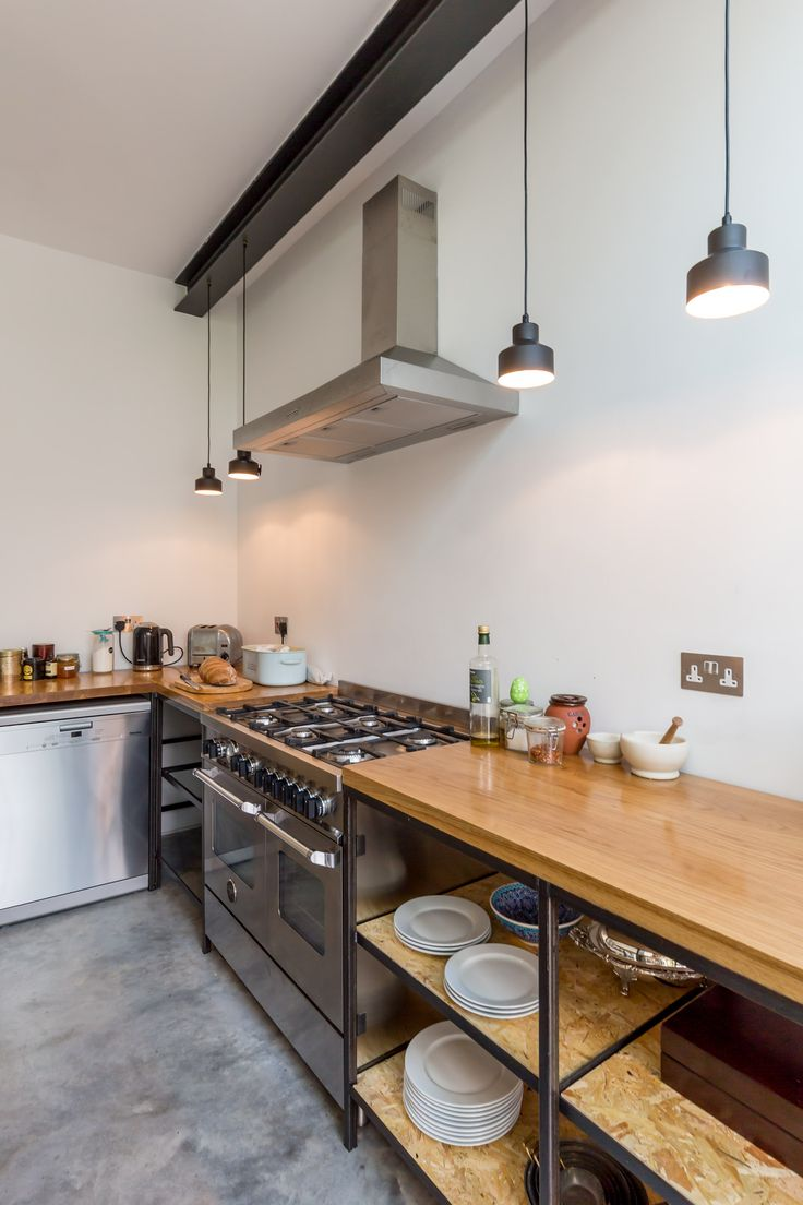 industrial kitchen | home renovation | open shelving | timber worktop | hanging lights | pendants | exposed steel | cooking haven