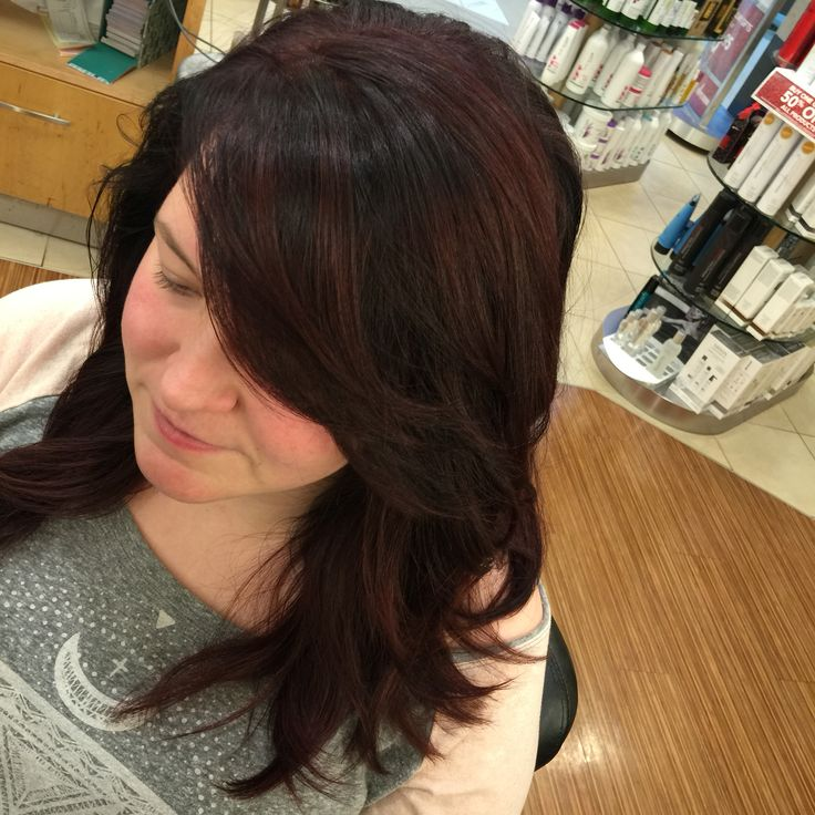 Deep red rood shade with deep violet lowlights and balayage with high lift red on the ends