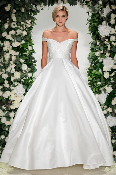 Simple elegant off-the-shoulder ball gown wedding dress. See photos of Anne Barge's Fall 2016 wedding dress collection.