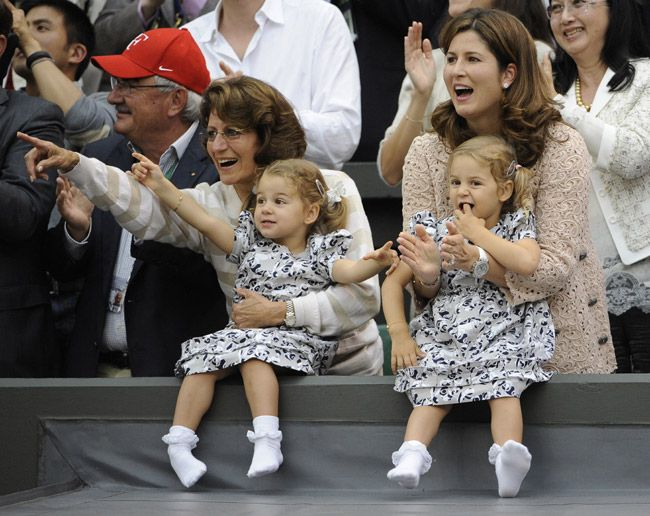 Roger Federer, playing in Wimbledon, admired by his wife and twin-daughters and his mother? mother-in-law?