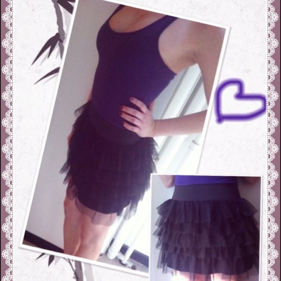 Purple Max Azria Miley Cyrus ballerina dress Material:   100% Poly (Bottom)  100% Rayon (Top)  Racer back , purple top, black ballerina skirt on bottom. It is a one piece dress. Worn once 😊 Max Azria Miley Cyrus Dresses