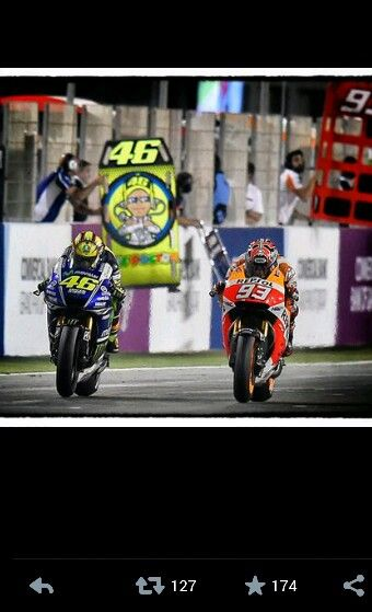 Marc marquez and Valentino Rossi battling for 1st in the opening race of the season at quatar 2014