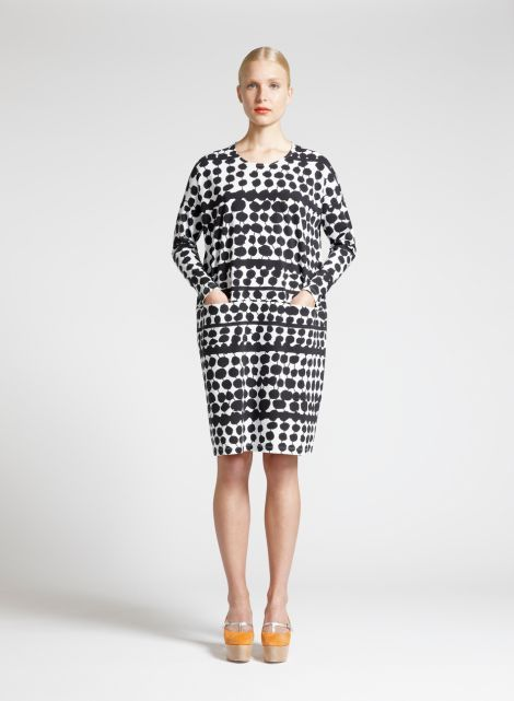 Nimla Dress with an exaggerated wide wide cut to above the knee hemline. 95% Cotton 5% Elastane