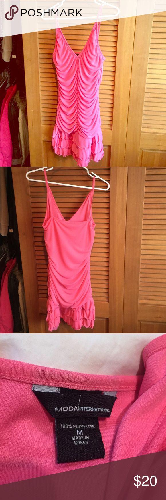 Cute pink mini dress So cute! Ruffles at the bottom, hits mid thigh, low cut. Great condition! Beautiful pink color. Moda International Dresses Mini