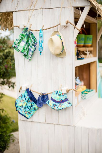 6. Decorative Accent- Baby beach items on rope, maybe on wall/window