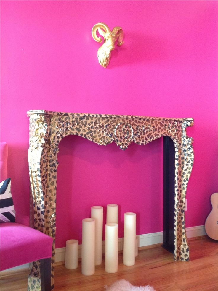 Glam leopard and metallic gold glitter faux finish mantel, hot pink wall, white candles. LOVE!!